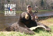 Chris from Horn Stars Outdoors with 250 lb bear