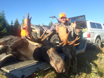 Bull Moose with proud hunter