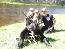 Ann, Taylor and Gordon with black bear