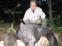 Martys bow hunts and bags this black bear