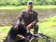 Kyles bags this black bear bow hunting at Taxis River Outfitters.