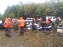 Taxis River outfitters and hunters meet in woods for a cook out lunch