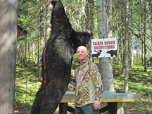 Sean's second bear hunt bags 340 lb black bear at Taxis River Outfitters