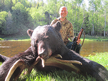 Sean is a happy hunter, bags black bear at taxis river outfitters